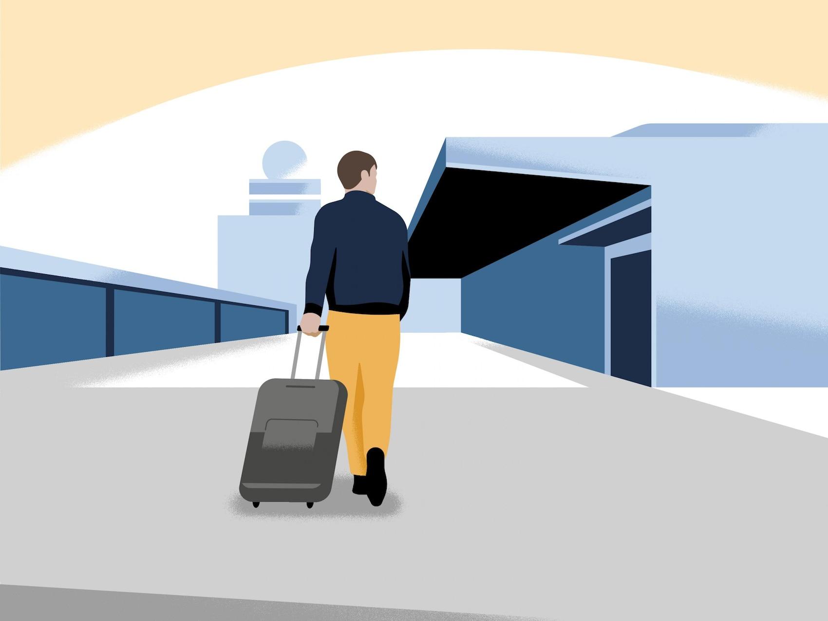 Mann mit Koffer am Terminal