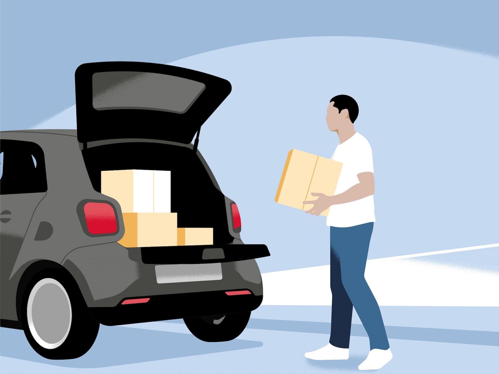 Un homme charge des paquets dans la smart