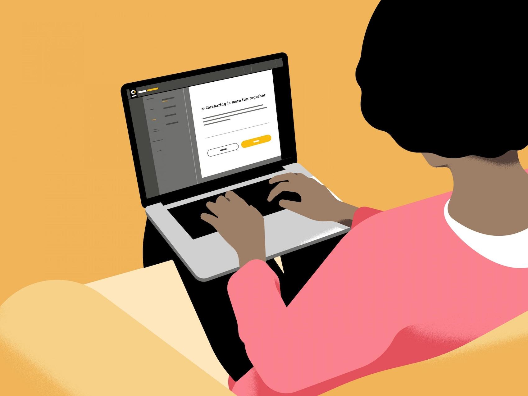 Eine Frau sitzt vor einem Computer